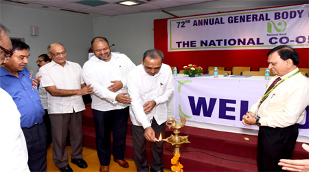 Hon'ble Chairman, Shri S. T. Kharmate lighting the traditional lamp at the Bank's 72nd AGM